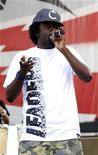 <p>Rapper Wale performs with his band at Virgin Mobile Free Fest in Columbia, Maryland August 30, 2009. REUTERS/Bill Auth</p>