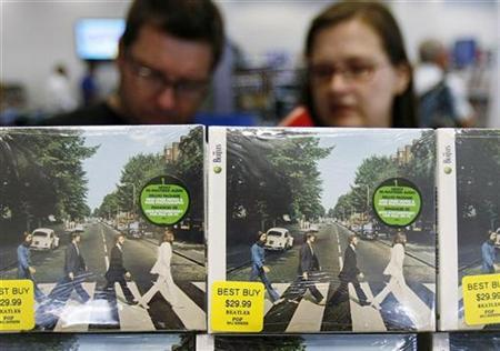 Customers browse Beatles collections during their launch in New York, September 9, 2009. REUTERS/Shannon Stapleton
