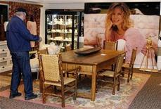 "<p>A visitor looks over furniture and other items at a press preview of items from an auction ""The Collection of Barbra Streisand"" in Beverly Hills October 12, 2009. REUTERS/ Fred Prouser</p>"