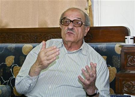 Syrian dissident Haitham Maleh speaks to Reuters during an interview at his office in Damascus April 14, 2006 file photo. REUTERS/Khaled Al Hariri