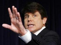 <p>Then Illinois Governor Rod Blagojevich waves to the media after he addressed questions about charges brought against him of conspiracy and bribery, including allegations he was seeking to benefit financially from his appointment of a successor to the U.S. Senate seat that was vacated by President-elect Barack Obama during a news conference in Chicago, in this December 19, 2008 file photo. REUTERS/Jeff Haynes/Files</p>