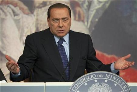 Italy's Prime Minister Silvio Berlusconi reacts during a news conference at Chigi palace in Rome October 9, 2009. REUTERS/Tony Gentile