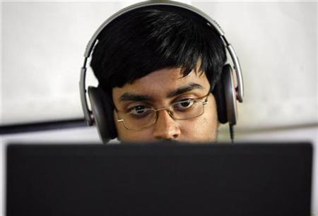 A researcher works on his laptop at the Microsoft India research centre in Bangalore in this June 24, 2009 file photo. REUTERS/Punit Paranjpe