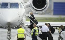 <p>Pop star Madonna boards the plane as she leaves Helsinki in this August 7, 2009 file photo. REUTERS/LEHTIKUVA/Roni Rekomaa</p>