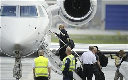 Pop star Madonna boards the plane as she leaves Helsinki in this August 7, 2009 file photo. REUTERS/LEHTIKUVA/Roni Rekomaa