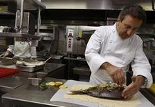 <p>French restaurateur Daniel Boulud works in the kitchen of his restaurant in Beijing August 15, 2008. REUTERS/Gil Cohen Magen</p>