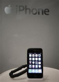 An Apple iPhone 3GS sits on a cradle at a Singtel showroom ahead of the phone launch this evening in Singapore in this July 10, 2009 file photo. REUTERS/Tim Chong