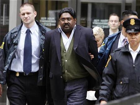 Galleon hedge fund partner Raj Rajaratnam (L) is escorted by FBI agents after being taken into custody in New York October 16, 2009. REUTERS/Brendan McDermid