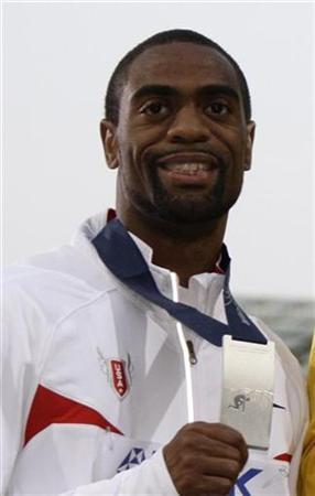 Tyson Gay of the U.S.displays his silver medal during the awards ceremony for the men's 100 meters at the world athletics championships at the Olympic stadium in Berlin August 17, 2009. REUTERS/Wolfgang Rattay