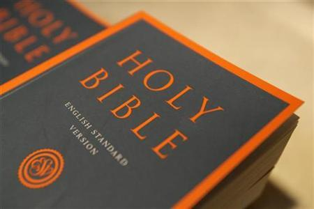 A bible is seen on display at a book stand at St Peter's Barge, Britain's only floating Anglican church, in the financial district of Canary Wharf in London, August 20, 2008. REUTERS/Simon Newman