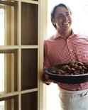"<p>An undated handout photo shows chef John Besh smiling as he holds a dish. REUTERS/Courtesy ""My New Orleans: The Cookbook (Andrew McMeel Publishing. October 2009/Handout MARKETING OR ADVERTISING CAMPAIGNS</p>"