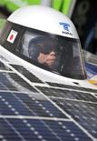 <p>A driver operates the Tokai Challenger solar car in the Australian outback on its way to winning the 2009 Global Green Challenge, October 27, 2009. REUTERS/Global Green Challenge/Handout</p>