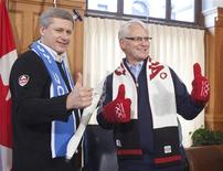 <p>Prime Minister Stephen Harper holds an Olympic torch while giving the thumbs up with Premier Gordon Campbell in Victoria, British Columbia, October 29, 2009. REUTERS/Andy Clark</p>