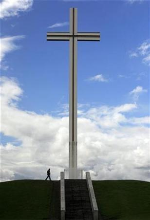 A man walks past the Papal Cross in Phoenix Park in Dublin, Ireland in this May 20, 2009 file photo. REUTERS/Cathal McNaughton
