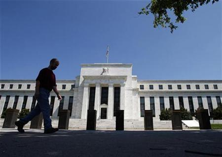 A man walks in front of the U.S. Federal Reserve building in Washington, June 24, 2009. REUTERS/Jim Young