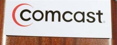 <p>Le premier câblo-opérateur américain Comcast prévoit d'ajouter cette année à son service de vidéos à la demande une centaine de titres le jour même de leur sortie en DVD, alors que son catalogue n'offrait en 2008 que 35 vidéos de ce type. /Photo d'archives/REUTERS</p>