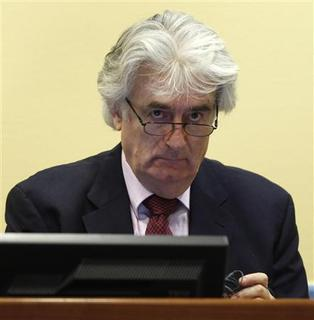 Former Bosnian Serb leader Radovan Karadzic appears in the courtroom of the ICTY War Crimes tribunal in The Hague November 3, 2009. REUTERS/Michael Kooren