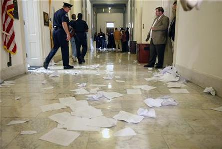 A shredded copy of the proposed healthcare reform legislation lies in the hallway outside Speaker of the House Nancy Pelosi's office on Captiol Hill after a protest against reforms, November 5, 2009. REUTERS/Kevin Lamarque
