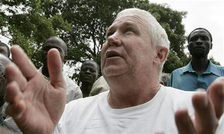 Zimbabwe's main opposition Movement For Democratic Change (MDC) national treasurer and nominee deputy minister of Agriculture Roy Bennet gestures as he leaves Mutare remand prison in Mutare 300 km (188 miles) east of the capital Harare, in this March 12, 2009 file photo. REUTERS/Philimon Bulawayo/Files