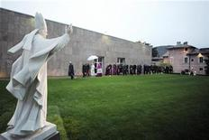 <p>Pope Benedict XVI walks near a statue of Pope Paul VI to enter a museum in Concesio, near Brescia November 8, 2009. REUTERS/Osservatore Romano</p>