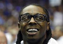 <p>Rap artist Lil Wayne sits courtside during Game 5 of the NBA Finals basketball game between the Orlando Magic and the Los Angeles Lakers in Orlando, Florida June 14, 2009. REUTERS/Hans Deryk</p>
