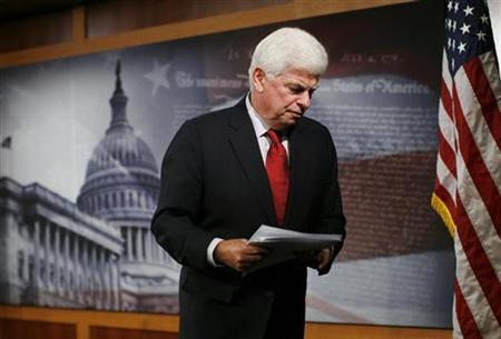 Senate Banking Committee Chairman Christopher Dodd leaves a news conference about the mortgage crisis on Capitol Hill in Washington in this September 16, 2008 file photo. Dodd will unveil long-awaited draft legislation on financial regulation reform on Tuesday, his office said on Monday. REUTERS/Jim Young