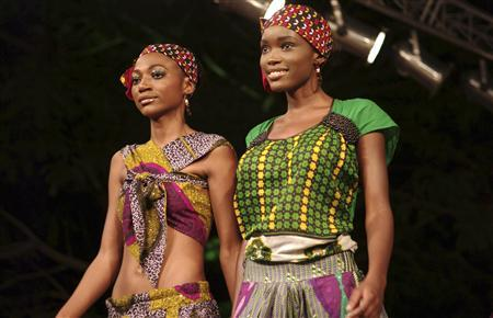 Models wear creations of bright colours and traditional cloth stitched into figure-hugging mini-dresses at Swahili Fashion Week in Dar es Salaam November 5, 2009. REUTERS/Katrina Manson