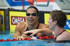 <p>Kaio Márcio sorri após quebrar recorde mundial dos 200m borboleta na Copa do Mundo em piscina curta em Estocolmo. REUTERS/Fredrik Sandberg/Scanpix Sweden</p>