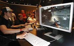 "<p>Visitors play the game ""Karma"" based on the Second World War at an exhibition stand at the Games Convention Online 2009 fair in the eastern German city of Leipzig in this July 31, 2009 file photo. REUTERS/Fabrizio Bensch</p>"