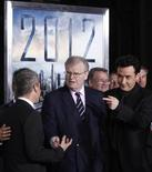 "<p>Cast member John Cusack (R) and Sony Corporation Chairman, Chief Executive Officer and President Howard Stringer (C) interact with others at the premiere of the film ""2012"" at Regal Cinemas LA Live in downtown Los Angeles November 3, 2009. REUTERS/Danny Moloshok</p>"