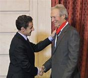 <p>France's President Nicolas Sarkozy (L) shakes hands with U.S. actor and director Clint Eastwood after Eastwood received the Commandeur de la Legion d'Honneur award during a ceremony at the Elysee Palace in Paris, November 13, 2009. REUTERS/Thibault Camus/Pool</p>