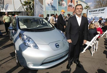 Nissan president and CEO Carlos Ghosn poses with the Nissan Leaf all-electric vehicle, a five-passenger hatchback, during its North American debut at the Nissan Leaf Zero Emissions Tour stop in Los Angeles, California November 13, 2009. REUTERS/Fred Prouser