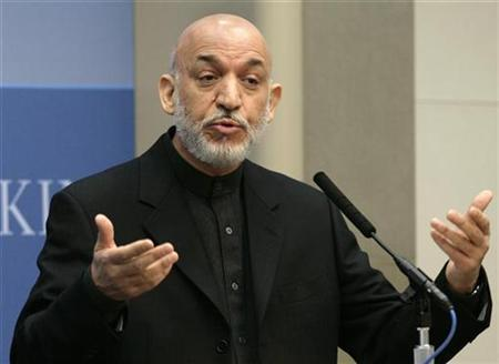 "Afghanistan's President Hamid Karzai speaks during a discussion on ""Governance, Growth and Development in Afghanistan"" at the Brookings Institution in Washington May 5, 2009. REUTERS/Yuri Gripas"