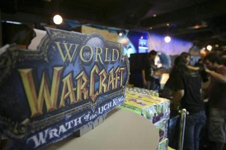Customers redeem their copies of ''Wrath of the Lich King'' during its launch in Singapore November 14, 2008. ''Wrath of the Lich King'' is the second expansion set for World of Warcraft, a Massively Multiplayer Online Role Playing Game (MMORPG) by Blizzard Entertainment, the games unit of France's Vivendi SA. REUTERS/Alywin Chew