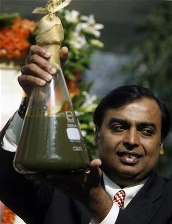 Mukesh Ambani, Chairman of Reliance Industries, holds a jar containing the first crude oil produced from their company's KG-D6 block in the country's east coast at a news conference in Mumbai September 21, 2008. REUTERS/Punit Paranjpe