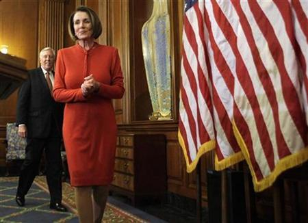 Speaker of the House Nancy Pelosi (R) with Majority Leader Steny Hoyer (D-MD) arrives at a news conference about the House vote on health care reform on Capitol Hill in Washington November 7, 2009. REUTERS/Yuri Gripas