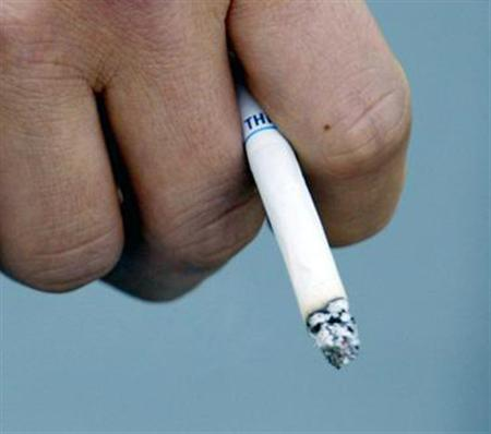 A smoker holding a cigarette in a file photo. REUTERS/File