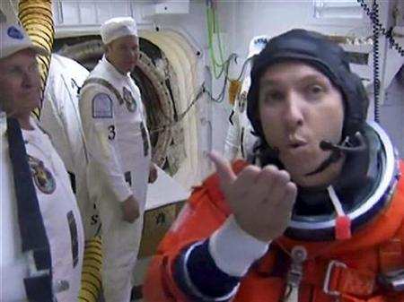 Astronaut Randy Bresnik blows a kiss to the camera as he prepares to board the Space Shuttle Atlantis before launch from the Kennedy Space Center in Florida November 16, 2009. REUTERS/NASA TV