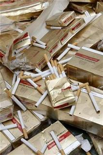 Cartons of contraband cigarettes are put on display at the Finance Ministry in Paris on September 4, 2008. REUTERS/Charles Platiau