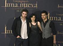 "<p>Robert Pattinson, Kristen Stewart and Taylor Lautner pose during a photocall to promote ""The Twilight Saga: New Moon"" in Madrid, November 12, 2009. REUTERS/Sergio Perez</p>"