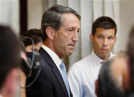 South Carolina Governor Mark Sanford pauses as he speaks to the media about his secret trip to Buenos Aires, Argentina and admits to an extramarital affair at the State House in Columbia, South Carolina June 24, 2009. REUTERS/Tim Dominick/The State