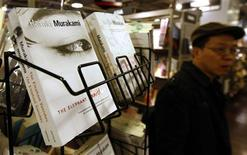 <p>A man walks past Japanese author Haruki Murakami's books in English on display at a book store in Tokyo, November 18, 2009. REUTERS/Kim Kyung-Hoon</p>