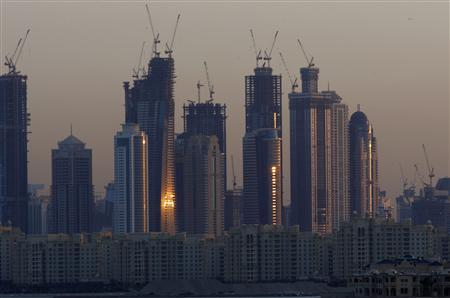Dubai Marina's tower blocks rise over the Shoreline Apartments on Nakheel's Palm Jumeirah in Dubai, November 26, 2009. REUTERS/Steve Crisp