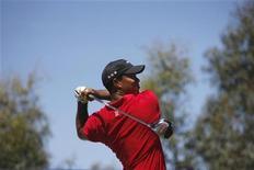<p>Un'immagine d'archivio del golfista numero uno al mondo, lo statunitense Tiger Woods. REUTERS/Mick Tsikas (AUSTRALIA SPORT GOLF)</p>