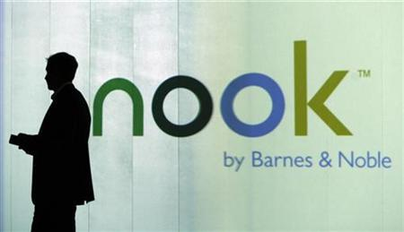 William Lynch, Presisent of of Barnes & Noble.com, is seen as a silhouette during the launch of nook, the Wireless eBook Reader, at a news conference in New York October 20, 2009. REUTERS/Shannon Stapleton
