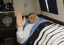 <p>Canadian astronaut Robert Thirsk rests in a vehicle after he returned to earth in the Russian Soyuz space capsule in the steppe near the town of Arkalyk, in northern Kazakhstan, December 1, 2009. REUTERS/Sergei Remezov</p>