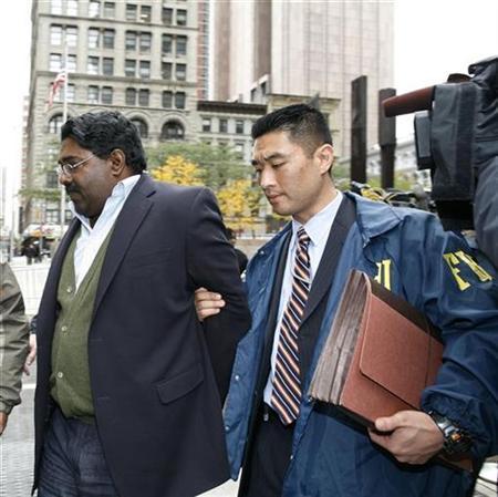 Galleon hedge fund partner Raj Rajaratnam (L) is escorted by FBI agents after being taken into custody in New York, October 16, 2009. REUTERS/Brendan McDermid