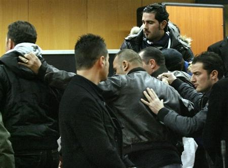 Mafia informant Gaspare Spatuzza is led by Italian police officers into a courtroom in Turin, December 4, 2009. REUTERS/Alessandro Garofalo