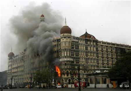 The Taj Mahal hotel is seen engulfed in smoke during a gun battle in Mumbai November 29, 2008. REUTERS/Arko Datta