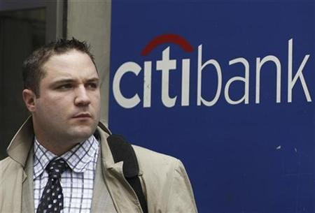 A man stands outside a Citi bank branch in New York August 13, 2009 file photo file photo. REUTERS/Lucas Jackson